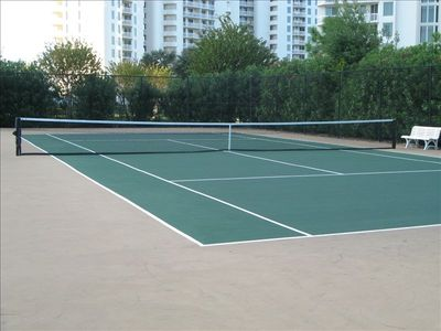There are four tennis courts and a full size basketball court on the property