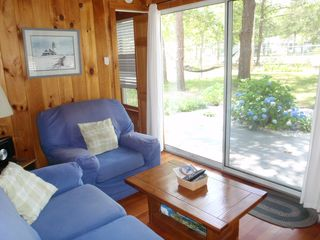 West Yarmouth cottage photo - Sunroom. Cozy area to relax, take in the views, or step out onto the deck.
