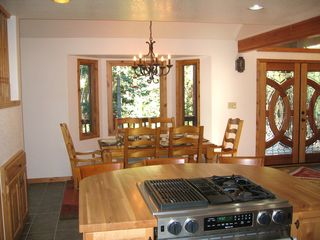 Blue River house photo - Kitchen has two stoves and an island bar