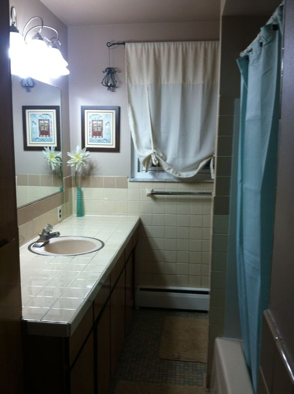 Two bathrooms both have showers. This one has a bathtub the other is standing.