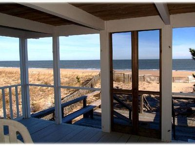 First floor screened porch opening directly onto the beach