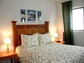 Taos Ski Valley condo rental - 2nd Bedroom. Queen w/ closet and attached bathroom. Mountain Views.