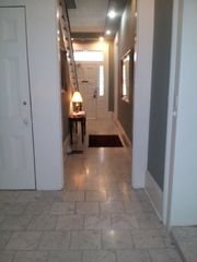 New Orleans studio photo - Foyer / Hallway through main house to main door exiting on St. Louis Street