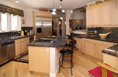 Kitchen is fully equipped & adjacent to breakfast rm & laundry/mud room!