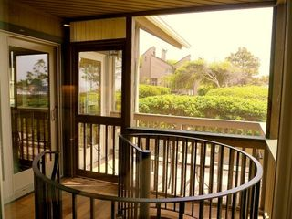 Kiawah Island villa photo - 2nd floor screened in porch. Spiral staircase leads to first floor porch.