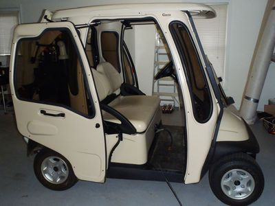 Fully enclosed golf cart in garage
