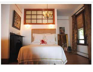 Newport house photo - Pelham Room; queen bed, raw silk headboard ornamental fireplace, oak armoire