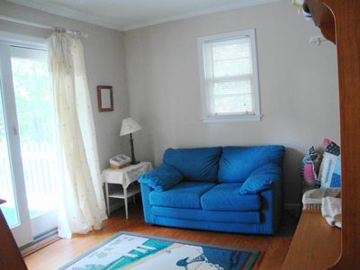 Anderson house rental - Upper level laundry/sitting room opens to sundeck. Loveseat opens to child bed.