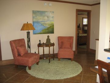 Spacious rooms, includes this upstairs landing. 3 Master suites & Lanai Upstairs