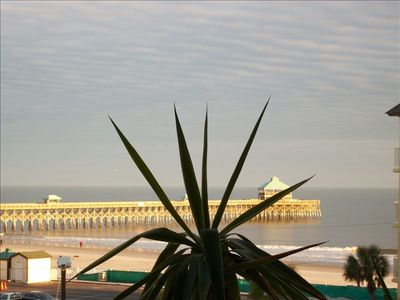 View of the pier and beach from the patio