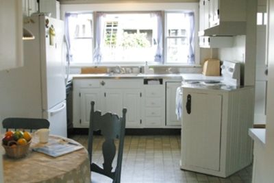Well-stocked, eat-in kitchen for 4 has an abundance of natural light.