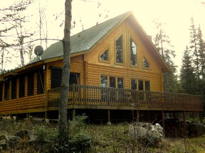Ely cabin rental - Three bedroom log cabin with screened porch and deck sits at the end of the road