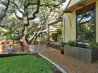 Austin cottage rental - View of the beautiful grounds, water feature, large deck and entertaining areas.