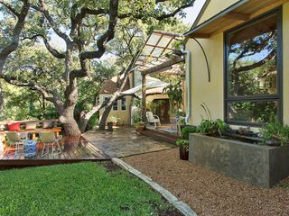 Austin cottage photo - View of the beautiful grounds, water feature, large deck and entertaining areas.
