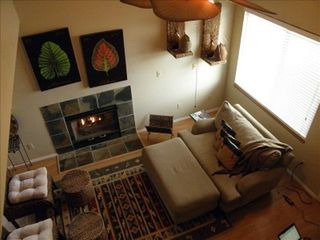 Manitou Springs townhome photo - Living room with fireplace, great for relaxing and conversation. Very cozy! HDTV