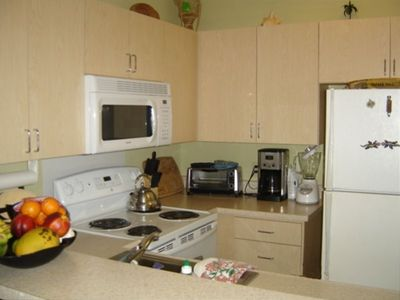 Kitchen w/quality utensils, plates, cutlery, microwave, blender, everything