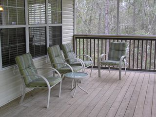 Suwannee River house photo - Enjoy screened-in back porch with view of river.