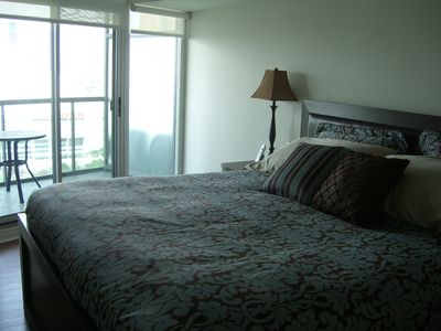 Toronto condo rental - Master bedroom with private second balcony.