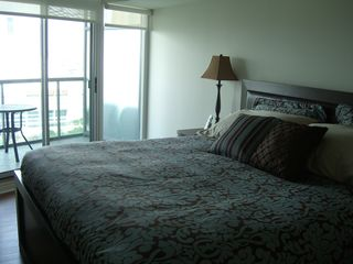 Toronto condo photo - Master bedroom with private second balcony.