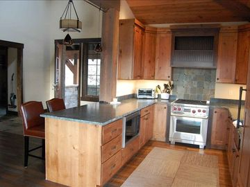 Chef's kitchen with all stainless steel Wolf appliances and granite countertops