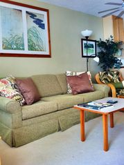 Haleiwa condo photo - new comfy couch w/ converter queen bed