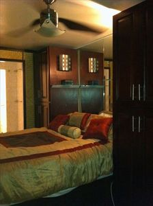 BR2 - Queen platform bed, custom wardrobes with glass shelves and sconces