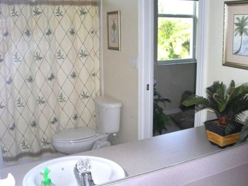 Bath #2 can be used as a private bath for bedroom 2. Beautiful tropical decor