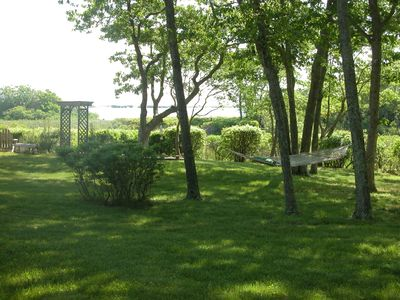 Idyllic secluded lawn with boardwalk to island