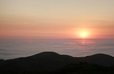 Maui sunset from Haleakala volcano. The crater rim above the clouds at 10,000 ft