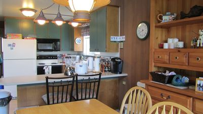 Full kitchen with Keurig coffee maker and complimentary coffee and tea station.