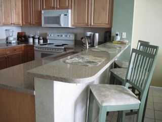 Stocked kitchen with stone countertops - Majestic Sun condo vacation rental photo