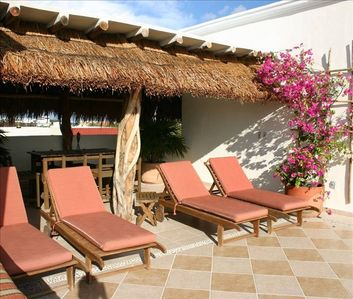 A private roof top Palapa and sunchairs for private time in the sun!