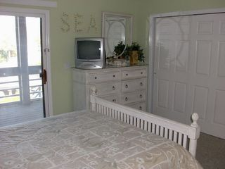 Seabrook Island villa photo - Master bedroom with private screened patio. Upgraded with California Closets