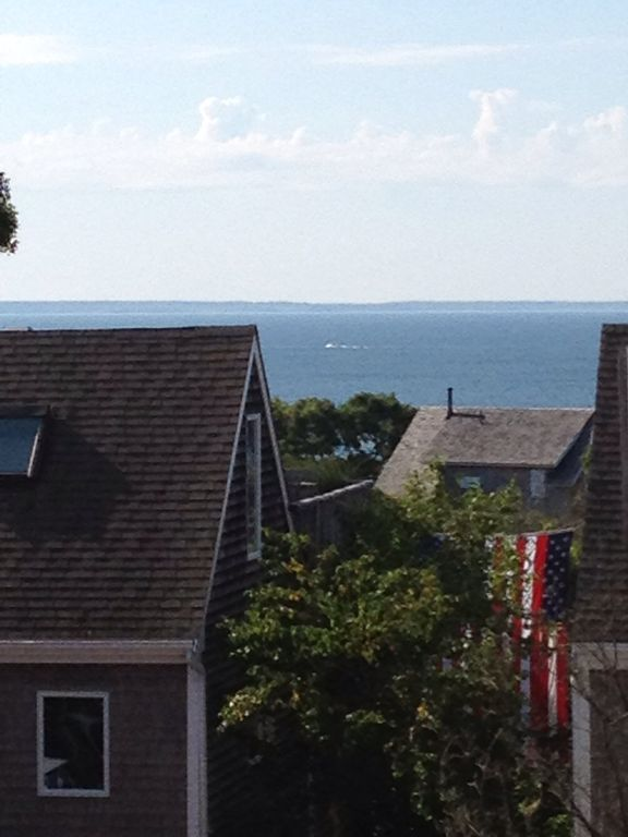 Water view from edge of third floor deck on a clear summer day.