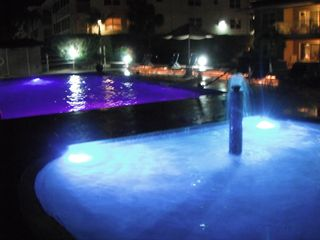 Grand Cayman condo photo - night time at the pools