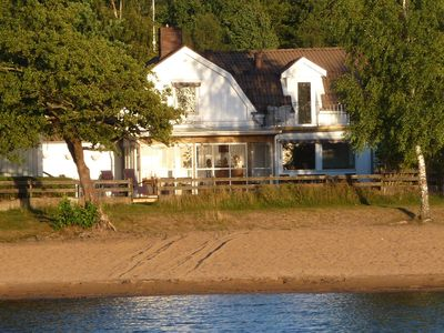 Cosy beach house with 3 bedrooms, directly at the sandy beach, evening sun, Multi Sauna, fishing
