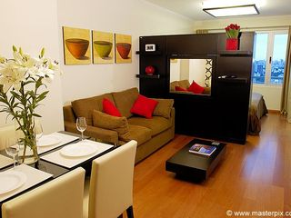 Palermo apartment photo - The TV wall provides privacy from bedroom yet lets in natural sunlight. Cool huh