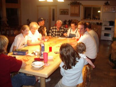 family around dining table playing games