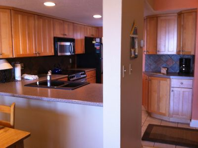Kitchen, enlarged and updated with maple cabinets, stainless appliances.