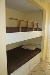 The Summit condo photo - The hall bunks are twin size. The rail turns into a ladder.