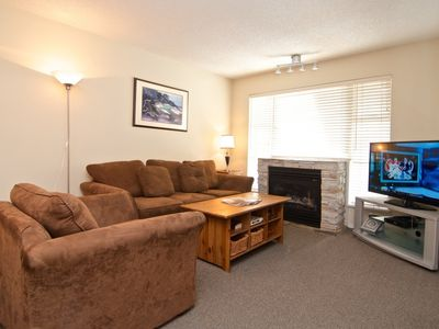 Spacious Living room with big screen TV, Sofa bed and fireplace