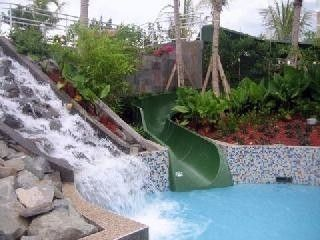 Loiza condo photo - Waterfall and Pool slide