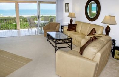 Leather Couch, Sofa Lamp; Chair Facing Gulf. The view is 4 windows  W-I-D-E
