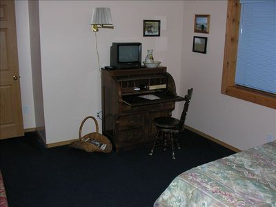 Antique desk in big master bedroom.