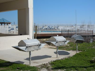 STAINLESS BAR B Q s ADJACENT TO PICNIC TABLES AND POOLS