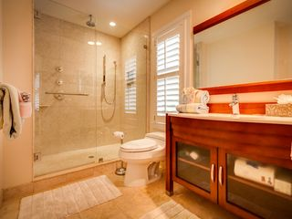 Key West villa photo - The master bathroom has a handsome custom glass shower.