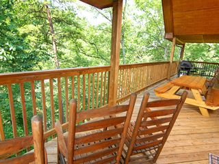 Pigeon Forge cabin photo - Upper deck - gas grill, picnic table, bistro table and chairs, and rockers.