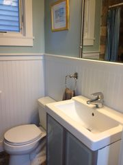 Provincetown condo photo - Bathroom appointed with beadboard