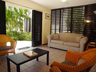 Cabo Rojo villa photo - Living room also has a door that leads you to the pools and garden areas.
