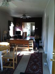 Portland house photo - Granddaughter running through Living Room. View from open front door.